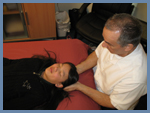 Tony Franco is treating client with Cranial Sacral therapy
